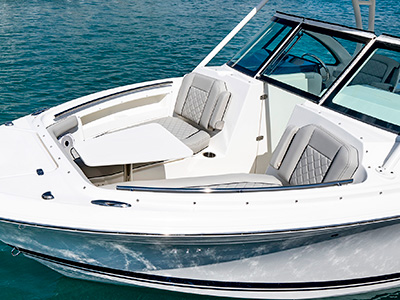A side view of forward lounge seating on the 25' DC 246 Pursuit Dual Console Boat with removable table.