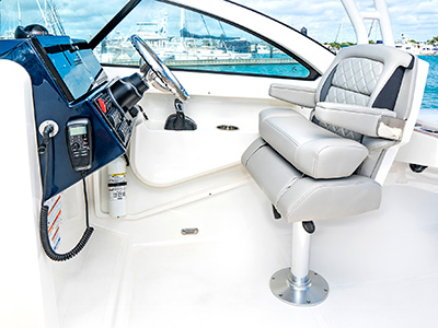 A view of adjustable helm seat with flip-up bolster on the 25' DC 246 Pursuit Dual Console Boat.