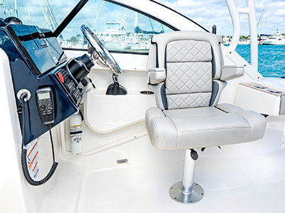 DA view of adjustable helm seat with flip-up bolster down on the 25' DC 246 Pursuit Dual Console Boat.