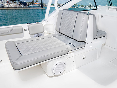A view extendable lounge seating on the 25' DC 246 Pursuit Dual Console Boat.
