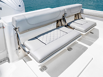 A view of fold away seating open on the 25' DC 246 Pursuit Dual Console Boat.