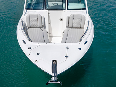 A front view of lounge bowrider seats on the DC 246 Pursuit Dual Console boat.