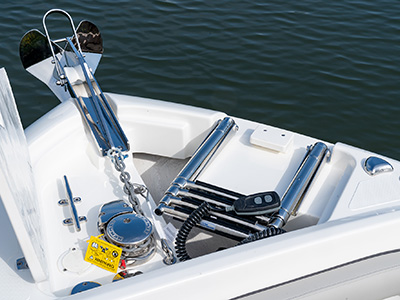 A windlass anchor system with remote next to a stowed beach boarding ladder on a new DC 246 Pursuit Dual Console Boat.