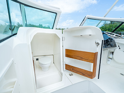 The port side head with an open door on a 25' DC 246 Pursuit dual console boat.