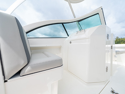 A companion seat and head door on a DC 246 Pursuit dual console boat.