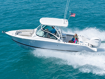 A DC 246 Pursuit dual console boat with a Yamaha engine is running in the ocean.