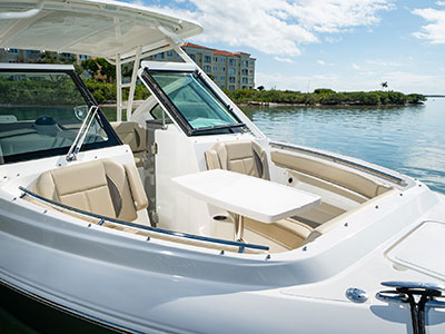 Bow area of Pursuit DC 266 dual console boat with fiberglass table.