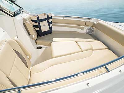 Bow area of Pursuit DC 266 dual console boat with sunpad filler