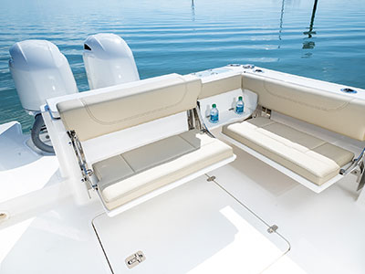 Folding transom seating of Pursuit DC 266 dual console boat.