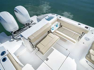 Aerial view of Folding transom seating of Pursuit DC 266 dual console boat.