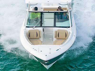 Aerial front view of family in a titanium Pursuit DC 266 dual console boat.