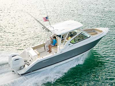 Aerial starboard side running shot of titanium Pursuit DC 266 dual console boat.
