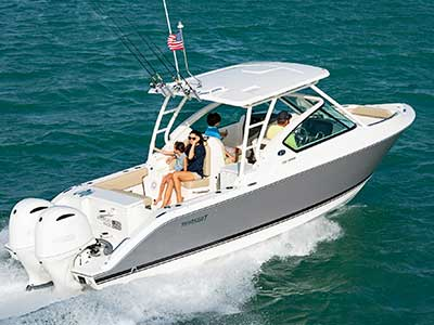 Starboard side shot of family on titanium Pursuit DC 266 dual console boat.