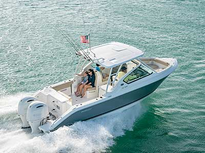 Starboard side profile shot of family in a titanium Pursuit DC 266 dual console boat.