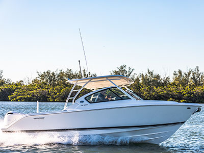 Starboard side profile shot of White Pursuit DC 266 dual console boat.