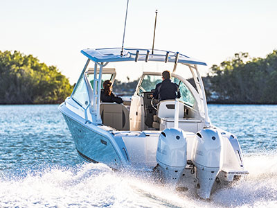 Rear view of white Pursuit DC 266 dual console boat.