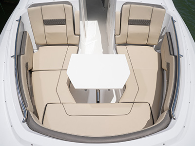 Forward bow seating and entertainment area of Pursuit DC 295 with Fiberglass bow table