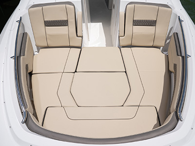 Forward bow seating and entertainment area of Pursuit DC 295 with sunpad filler