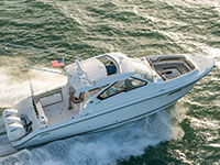 Aerial profile view of white Pursuit DC 365 dual console boat.
