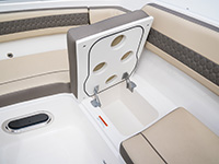 Pursuit DC 365 dual console boat forward seating with storage revealed.