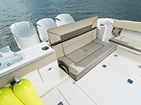 Pursuit DC 365 dual console boat cockpit social zone with seats down.
