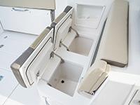 Pursuit DC 365 dual console boat cockpit seating storage.
