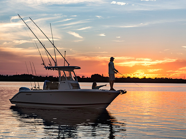 Sunset photo of C 238 with fisherman on the bow