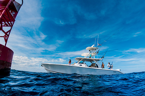 Profile view of white S 408 with tower and anglers in the cockpit