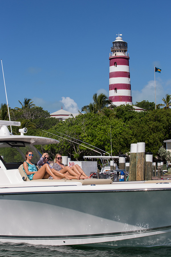 Full frame profile view of 3 woman lounging on S 408 bow sunpad