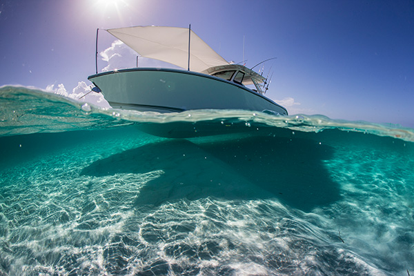 Water line view of anchored white S 408 with forward Mediterranean Sunshade open