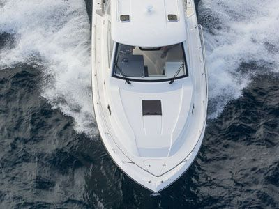 OS 325 Offshore aerial front view of bow with skylight over cabin with hardtop.