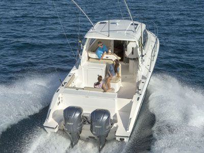 Aerial real view of white OS 325 Offshore with twin outboard engines.