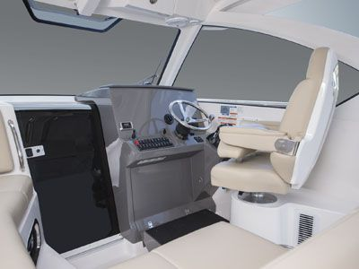 OS 325 Offshore bridge with helm and seating with Captain's chair and cabin door.