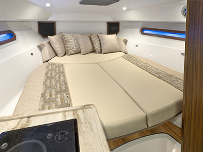 OS 325 offshore cabin V-berth without cover for overnighting on board.
