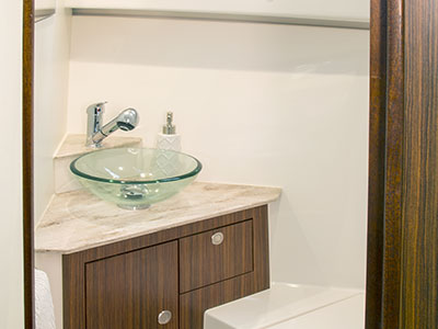 OS 325 Offshore cabin head with designer sink.