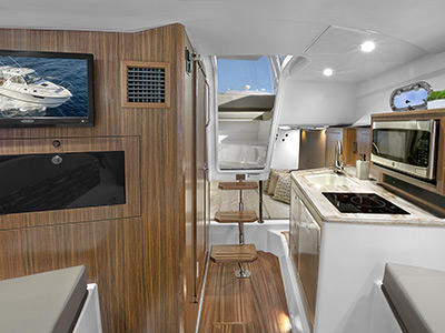 OS 325 cabin galley with Corian countertops and storage.