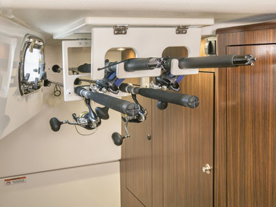 OS 325 Offshore cabin with ample fishing rod storage.