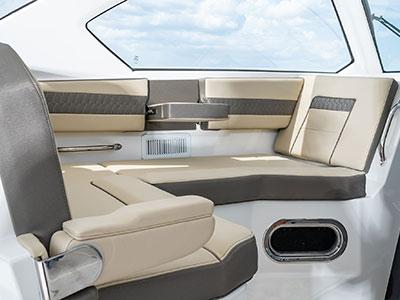 Detail view of OS 355 Molded Port Bridge Lounge Seating with Large Backrest, Folding Arm, Molded Footrest and Port Articulating Armrest.