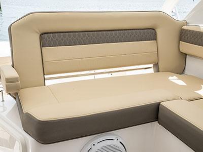 Detail view of OS 355 Rear Molded Port Bridge Lounge Seating with Large Backrest, Folding Arm, Molded Footrest and Port Articulating Armrest.