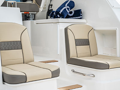 Detail view of OS 355 Molded Port and Starboard Aft Facing Seats with Insulated Storage Below.
