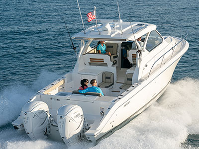 Aerial rear view of white OS 355 showing luxurious seating and social zones, fishing options and twin outboard engines.