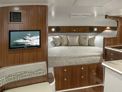 OS 385 Offshore boat cabin with berth for overnighting.