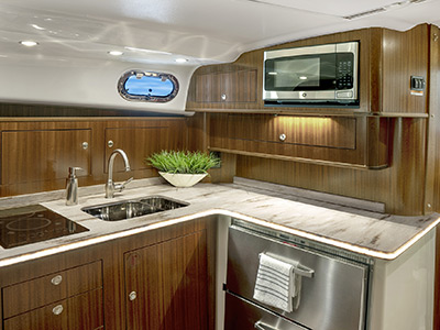 OS 385 offshore boat cabin well-appointed galley in cabin cruiser.