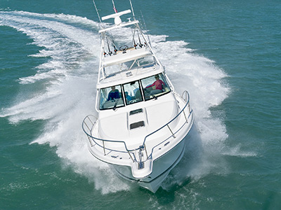 Front aerial view of white Flagship OS 385 Offshore boat with sport fishing tower.