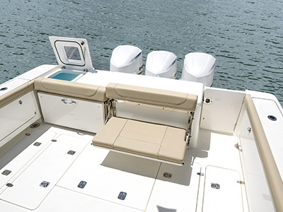 OS 385 Offshore transom featuring livewell and fold down seating and fish boxes.