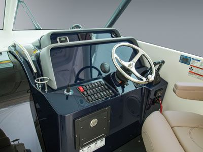 OS 385 detail shot of command console with steering and controls.
