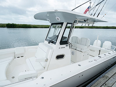 Detail of white S 268 Sport center console boat docked.