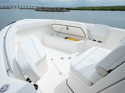 Detail view of S 268 Sport boat bow seating with ample storage space.