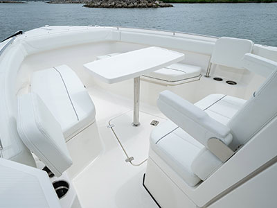 Detail of S 268 bow social zone with fiberglass table and optional lounge seating.