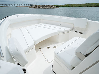 Detail of S 268 bow social zone with bow sunpad filler cushion and cup holders.